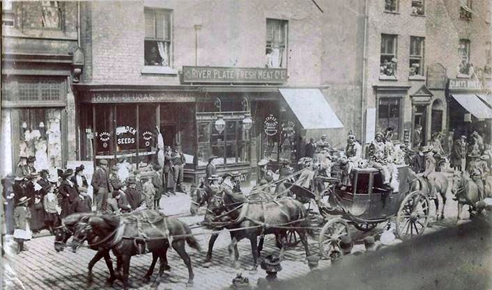 'Buffalo Bill Wild West and Congress of Rough Riders of the World' paraded along Moor Street with the Deadwood Stage. Note the original clucas Shop in the background.