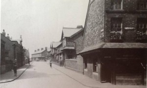 Derby Street West Circa 1910, Biggs motor dealers at 32 on the left, Rudds music shop at 28 and no 16 at either end of the second terrace