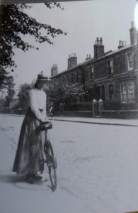 An unknown girl with her bike on Stanley Street around WW1