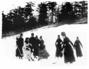 Isobel Stanley (in white dress) playing 'Shinny' in grounds of Rideau House, Ottawa.